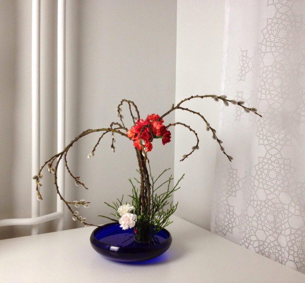 Willow catkins and carnations in blue container