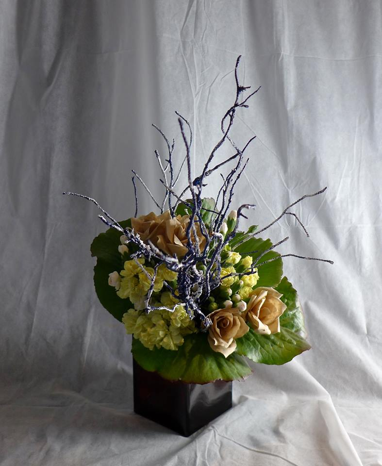 Wintery bouquet with bergenia, paper flowers, carnations and painted twigs