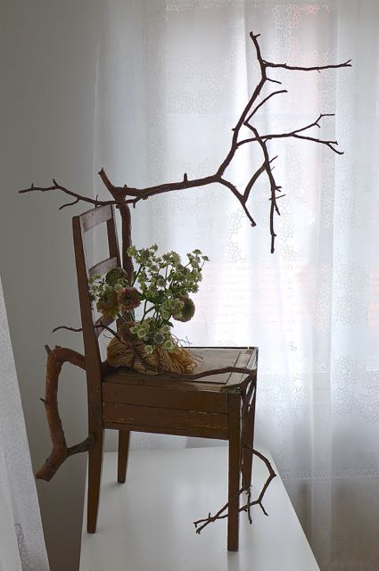 Chair customized with pine branch and flowers